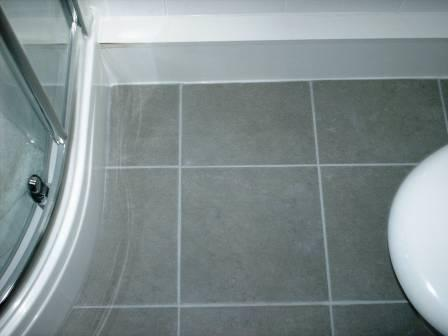 After Picture - Grout Colour restored on a Ceramic Tiled Bathroom Floor by the Tile Doctor